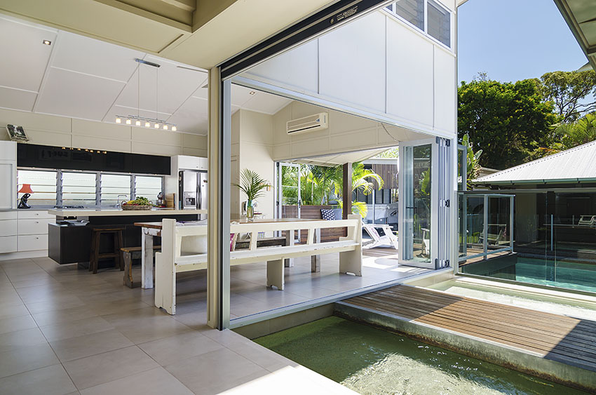 Open plan home with internal water feature by Propertyshoot Sunshine Coast